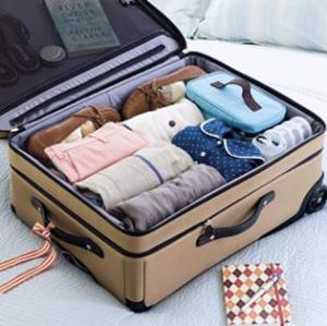 rolled-clothes-pack-tight-and-fit-snugly-into-any-size-or-shape-luggage